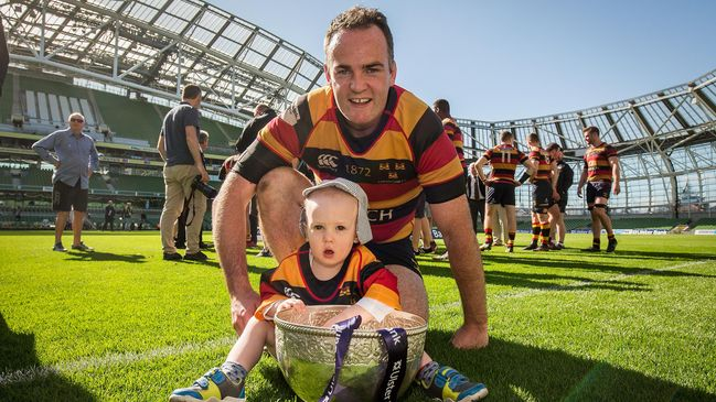 Scott Deasy and his son Peter with the Ulster Bank League trophy