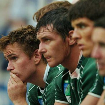 Some of Ireland's replaced players look on during the final minutes in Paris