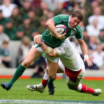 Ireland's stand-in captain Ronan O'Gara is tackled by England's Michael Lipman