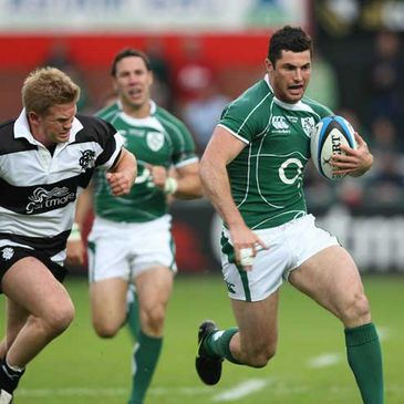 Ireland's Rob Kearney gets away from Barbarians scrum half Michael Claassens