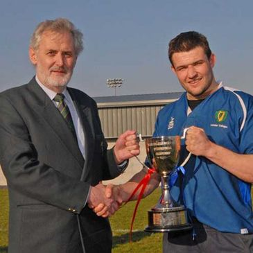Leinster captain Wesley Wojnar receives the trophy