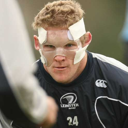 Leinster centre Michael Berne wearing a protective face mask