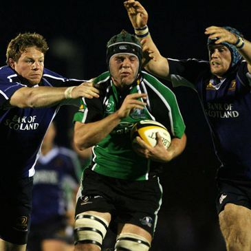 Connacht lock David Gannon is tackled by Leinster's Malcolm O'Kelly and Jamie Heaslip