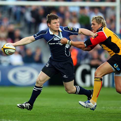Brian O'Driscoll looks to offload under pressure from Gareth Maule