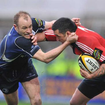 Leinster's Chris Whitaker gets to grips with Munster centre Rua Tipoki