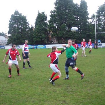 Tag rugby action at Malone RFC