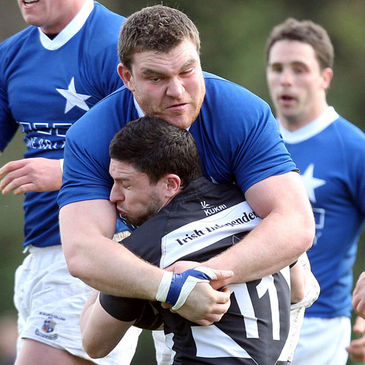 Rob Sweeney of St. Mary's tackles Old Belvedere winger David Mongan