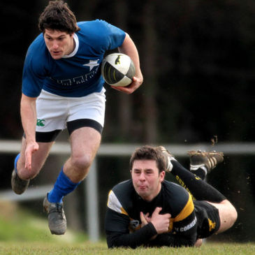 Ian McKinley gets past Young Munster's Willie Staunton