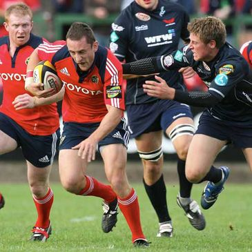 Munster centre Kieran Lewis on the attack against the Scarlets
