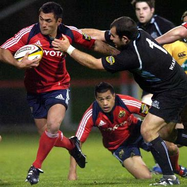 Munster centre Rua Tipoki is tackled by Glasgow's Ed Kalman