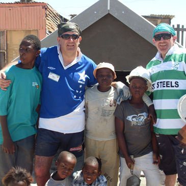 Niall Rynne and his brother Manus with the local children