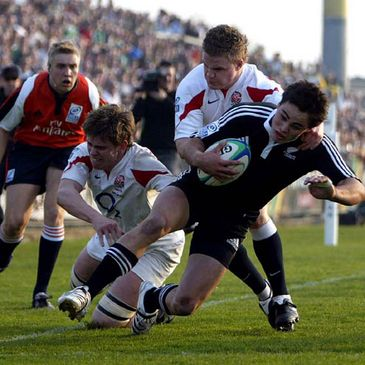 New Zealand's Zach Guildford is tackled as he goes for the English try line