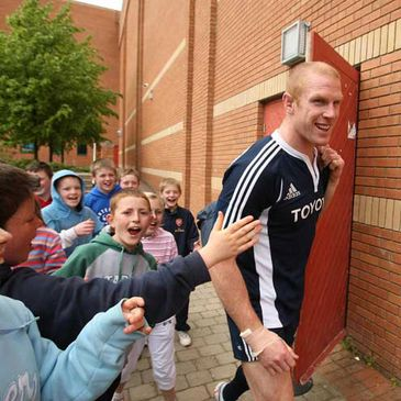 Paul O'Connell is mobbed by young fans on his way to training