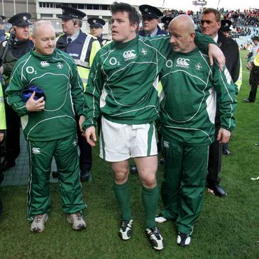 Brian O'Driscoll being helped off the Croke Park pitch