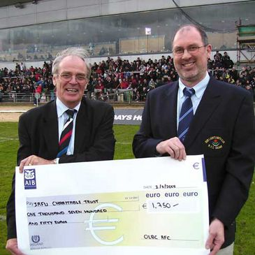 OLBC's Mick Turley presents a cheque to IRFU Charitable Trust Chairman Jeff Smith
