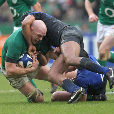 Paul O'Connell is tackled by Thierry Dusatoir