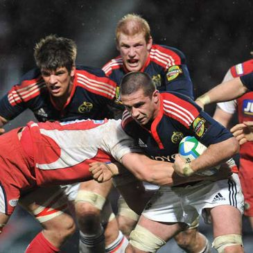 Munster flanker Alan Quinlan takes the ball on against Gloucester