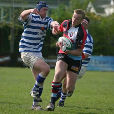 'Quins skipper Colin Atkinson on the attack against Dungannon