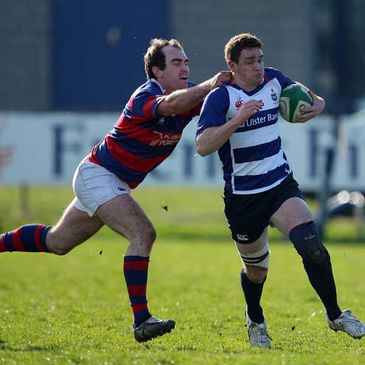 Blackrock centre Brian Canavan is tackled by Clontarf's Daragh O'Shea