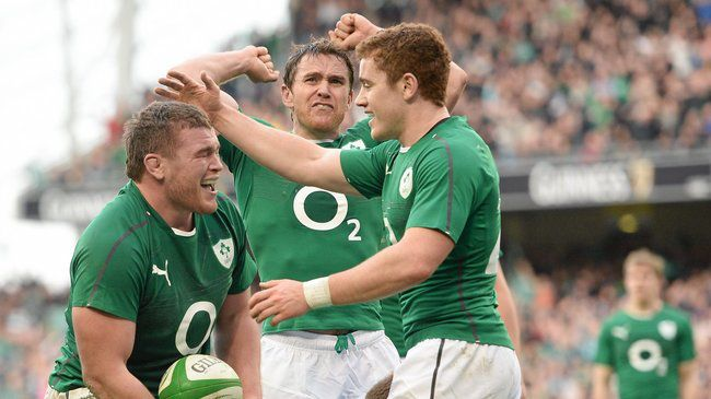 Eoin Reddan celebrates with Jack McGrath and Paddy Jackson
