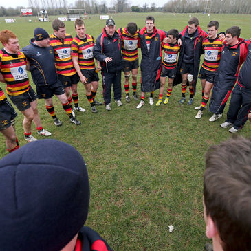 Head coach Mike Ruddock talks to his Lansdowne players