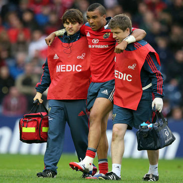 Munster's Simon Zebo is helped off the Murrayfield pitch