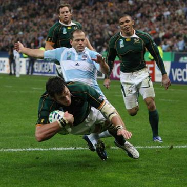 Felipe Contepomi cannot stop South Africa's Danie Rossouw from scoring
