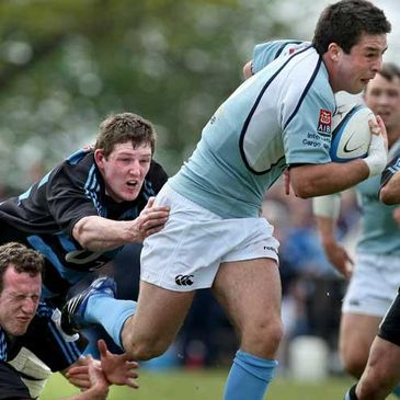 Garryowen out-half Willie Staunton is tackled by Shannon's Mike Kinsella and Fergal Walsh