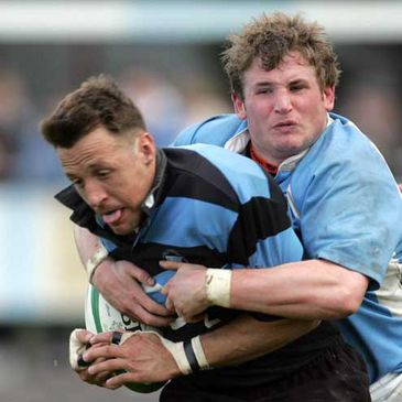 Shannon's Andrew Thompson is tackled by Garryowen captain Paul Neville