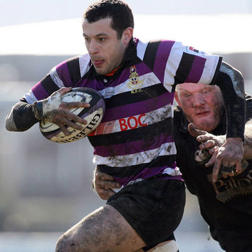 Terenure's David Cazabon is tackled by Ballymena lock Ian Caldwell
