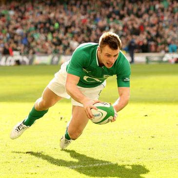 Tommy Bowe is pictured scoring a try against Italy