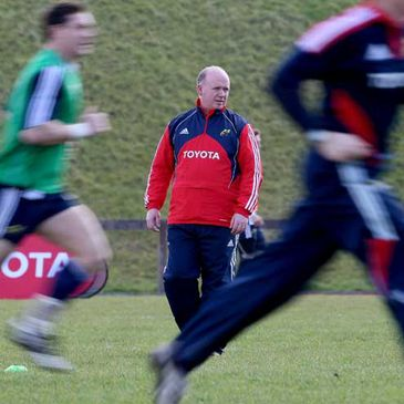 Munster coach Declan Kidney looking on at training