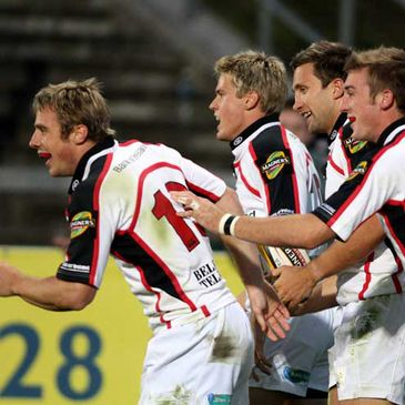 Ulster celebrate a try in their Magners League opener against the Ospreys