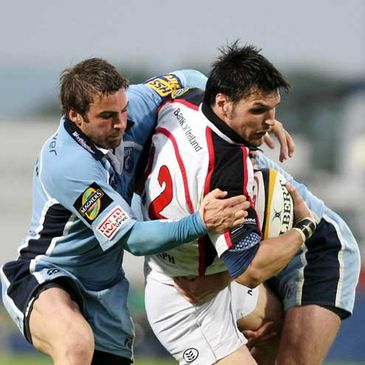 Ulster's Rob Dewey is tackled by Cardiff Blues out-half Nicky Robinson