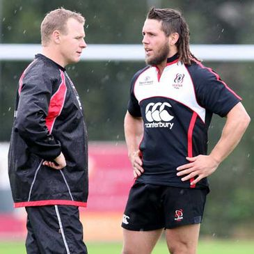 Mark McCall and Isaac Boss in conversation at training