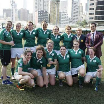 The Women's Sevens Squad with the Bowl trophy in Hong Kong